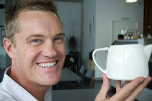 Johno Evans, co-owner of the Urban Cafe, with a teapot similar to the one that raised $6000 for Warkworth Hospice. Photo / Paul Estcourt