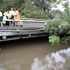 State emergency workers standing on a bridge in the Sydney suburb of Windsor watch rising waters as it covers a walkway under the Windsor Bridge on the Hawkesbury River after the flood gate of the Warragamba Dam were opened in Sydney. Photo / AP