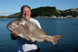 Stan Giles can't stop smiling over his 13kg snapper. Photo / Supplied