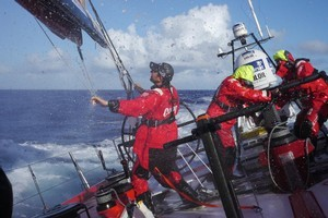 Andy McLean putting a reef in the mainsail onboard Camper with Emirates Team New Zealand. Photo / Volvo Ocean Race