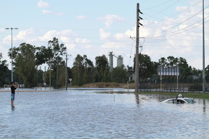 A submerged taxi on a flooded street in Wagga Wagga. Photo / Getty Images