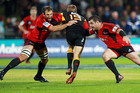 George Whitelock (L) and Corey Flynn of the Crusaders tackle Robbie Robinson of the Chiefs. Photo / Getty Images