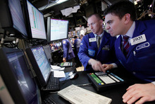 Specialists James Ahrens, left, and Robert Tuccillo work on the floor of the New York Stock Exchange. File photo / AP
