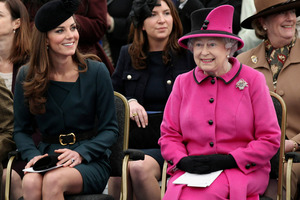 Britain's Queen Elizabeth II and Catherine, Duchess of Cambridge watch a fashion show at De Montfort University in Leicester, England. Photo / AP
