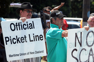 Members of the Maritime Union striking outside the Ports of Auckland over conditions and pay disputes. Photo / APN