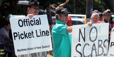 Members of the Maritime Union striking outside the Ports of Auckland. Photo / Janna Dixon