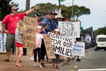 Striking Ports of Auckland workers, with their families in support, on the picket line outside the entrance to the port earlier this year. Photo / Natalie Slade