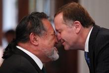 Prime Minister John Key (right) hongis with Maori Party co-leader and Maori Affairs Minister Pita Sharples. Photo / Mark Mitchell