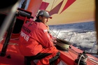 Andy McLean trimming onboard CAMPER with Emirates Team New Zealand during leg 4 of the Volvo Ocean Race. Photo / Hamish Cooper