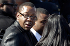 Singer Bobby Brown, left, is seen outside during the funeral of his ex-wife Whitney Houston in New Jersey. Photo / AP