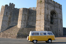A Volkswagen camper at Carnaevon Castle in Wales. Photo / Creative Commons image by Flickr user Nigel Hook