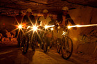 Cyclists don mining helmets to tackle the tunnels at Valkenburg. Photo / Supplied