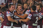 Daly Cherry-Evans of the Sea Eagles celebrates with his team mates after scoring a try. Photo /Getty Images