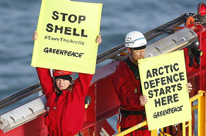 Actor Lucy Lawless and Greenpeace New Zealand activists on the second day of their protest to stop a Shell-contracted drillship from departing Port Taranaki. Photo / Greenpeace