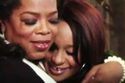Oprah Winfrey hugs Bobbi Kristina Houston during an interview.