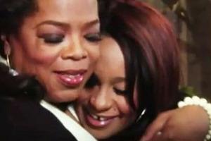 Oprah Winfrey hugs Bobbi Kristina Houston during an interview.