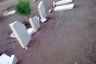 An image grab taken from YouTube on March 3, 2012 perportedly shows broken headstones at the Benghazi War Cemetery and the Benghazi British Military Cemetery. Photo / AFP