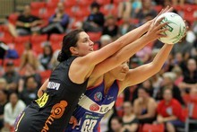 Magic's Jessie Waitapu (left) and Mystics' Rachel Rasmussen in action at Tauranga. Photo / Michael Bradley