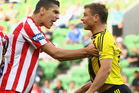 Eli Babalj of the Heart and Ben Sigmund of the Phoenix have words during their A-League clash. Photo / Getty Images