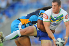 Josh McCrone looks to pass during the Raiders round two match against the Titans. Photo / Getty Images