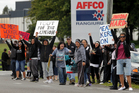 Locked-out meat workers protest outside the Affco meat works at Rangiuru. Photo / Alan Gibson