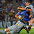 Matt Hodgson of the Force gets tackled by Victor Vito and Ben May of the Hurricanes. Photo / Getty Images