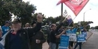 Watch: Striking port workers react