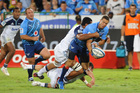 Filo Paulo of the Blues tackles Bjorn Basson of the Bulls during the 2012 Super Rugby match between Vodacom Bulls and Blues from Loftus Versfeld on March 10, 2012 in Pretoria, South Africa. Photo / Getty