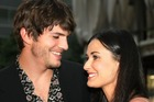 Demi Moore with ex-husband Ashton Kutcher in happier times. Photo / Getty Images