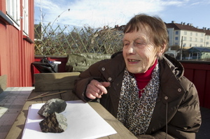 Anne Margrethe Thomassen looks at what is thought to be a meteorite that split in two after hitting the roof of her cottage in central Oslo on March 12, 2012. The meteorite was discovered on March 1