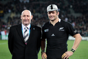 All Black captain Richie McCaw receives his 100th test cap from Jock Hobbs during the Rugby World Cup. Photo / Sarah Ivey