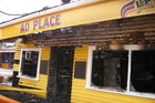 The takeaway outlet on Waiheke Island was almost totally destroyed by fire yesterday morning. Photo / Diana Worthy