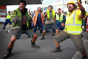 Wharfies perform a haka during the Ports of Auckland protest march.  Photo / Doug Sherring