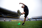 7-year-old Taine Wilson kicks a rugby ball during the Eden Park open day. Photo / Dean Purcell
