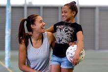 Leukaemia survivor Tamilla Khan, 13, gets to know Silver Ferns netball star Maria Tutaia. Photo / Dean Purcell