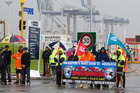 Accusations of aggression came from both sides of the dispute as more than 100 port workers and their supporters swelled the picket lines yesterday. Photo / Paul Estcourt