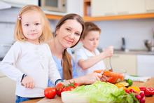 Getting the kids involved in preparing healthy meals and snacks is a good way to promote nutrition. Photo / Getty Images