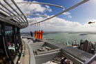 Volvo race crews participate in a Sky Walk on the Sky Tower. Photo / Ian Roman