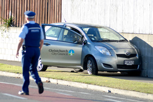 Police examine a crashed Christchurch City Council car that was part of the scene today following a man's rampage. Photo / Geoff Sloan