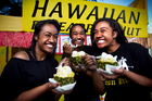 From left, Joanna Lee-Lo, Joella Lee-Lo and Tia Toiu enjoy their real deal pineapple and icecream. Photo / Natalie Slade