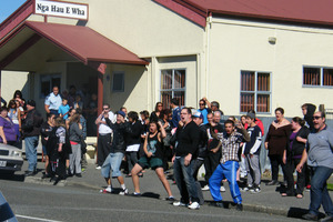 A haka was directed at the media outside the marae. Photo / Vaughan Elder