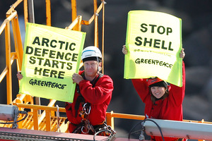 Actor Lucy Lawless and Greenpeace New Zealand activists protest to stop a Shell-contracted drillship from departing Port Taranaki for the remote Arctic. Photo / Supplied