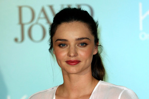 Miranda Kerr will conduct a free yoga class for 500 fans who upload their own I Will If You Will challenge. Photo / AP, Rob Griffith