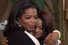 Oprah Winfrey, left, embraces Bobbi Kristina, daughter of the late singer Whitney Houston during an interview in Atlanta. Photo / Harpo Inc via AP