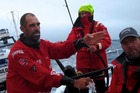 Stu Bannatyne points out the position of an opposition boat onboard Camper. Photo / Hamish Hooper/CAMPER ETNZ/Volvo Ocean Race