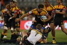 Richard Kahui with the ball is tackled during the match against the Brumbies. Photo / Getty Images