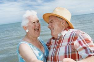 Close up of a Senior Couple Dancing at Water's Edge