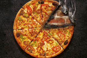 Hell's 'Pizza Roulette' comes with a warning 'It doesn't cost. But someone pays.' Photo / Hell Pizza