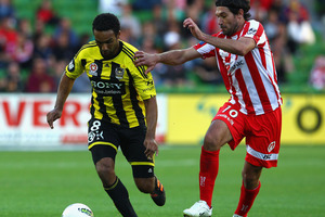 Paul Ifill of the Phoenix is chased Wayne Srhoj of the Heart during the round 23 A-League match between the Melbourne Heart and the Wellington Phoenix at AAMI Park. Photo / Getty Images