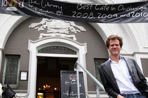Eoghan O'Sullivan stands outside one of his favourite haunts, The Library Cafe. Photo / Sarah Ivey